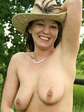 Busty mature chick strips and poses outdoors for us